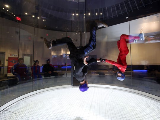 Chuck Owen of Skydive Jersey in  Pittstown, NJ, left, is guided by instructor Chris Dixon during a visit to iFly, an indoor skydiving place at Ridge Hill in Yonkers, with his colleagues, Dec. 21, 2015.