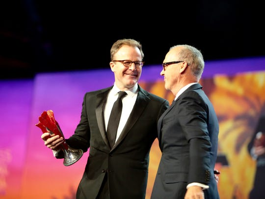 "Michael Keaton presents Tom McCarthy, who co­wrote and directed ""Spotlight,"" with the Sonny Bono Visionary Award at the Palm Springs International Film Festival awards gala on Saturday night."