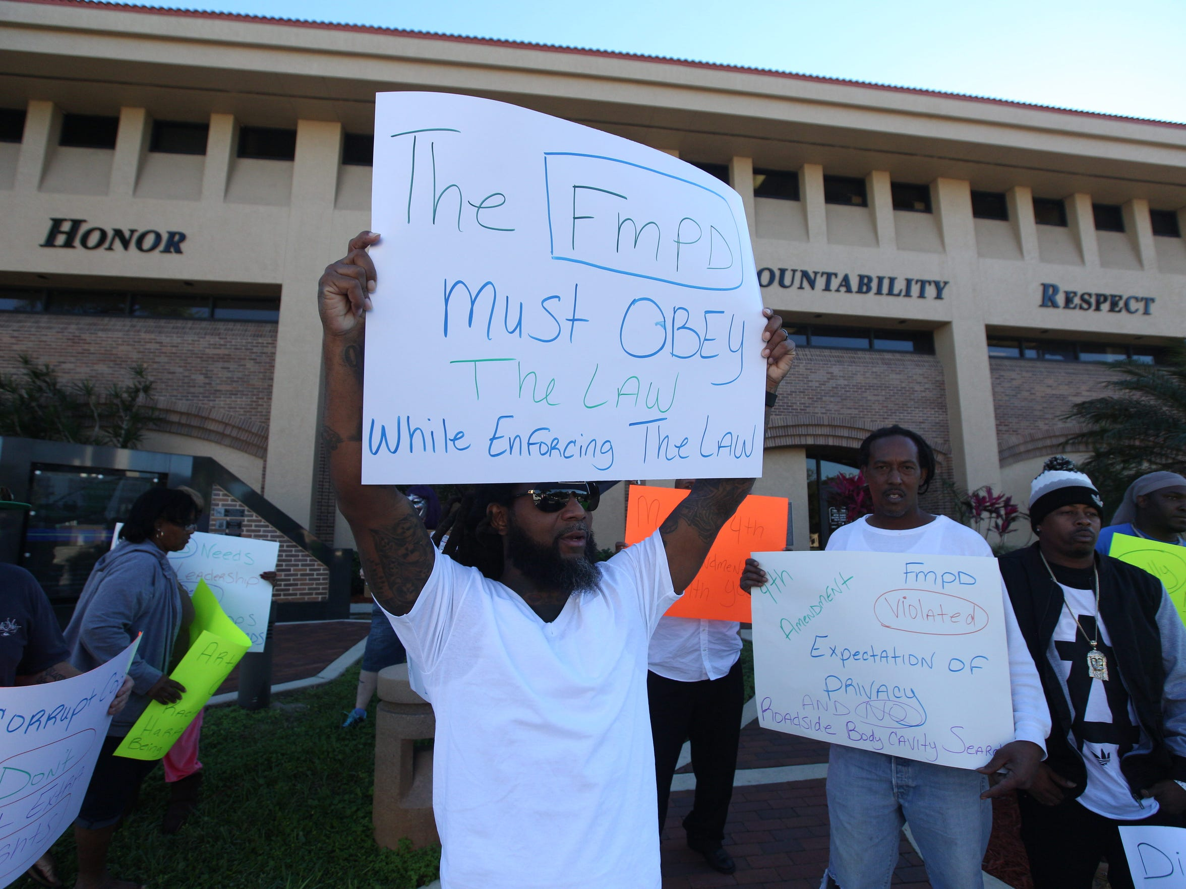 A small group of people protested alleged police misconduct and illegal searches at the Fort Myers Police Department.  The group then marched to and attended the Fort Myers City Council meeting.