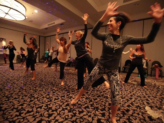 Yoga instructors work out with YogaFit founder Beth Shaw, at the Rivera Resort and Spa in Palm Springs, on Tuesday, January 5, 2015.