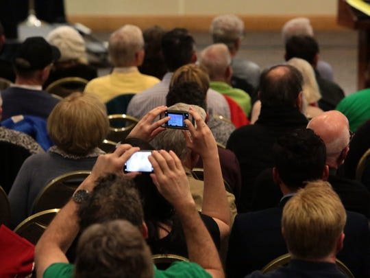 Palm Springs residents take photos of the map of the  of the planned  downtown Palm Springs during a development study session on Wednesday, January 6, 2016 at the Palm Springs Convention Center.