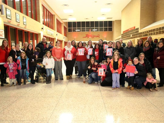 Parents  of kids in the North Rockland School District pose for a photo after speaking to the Board of Education advocating for full-day kindergarten during a meeting at North Rockland High School on Jan. 5, 2016.