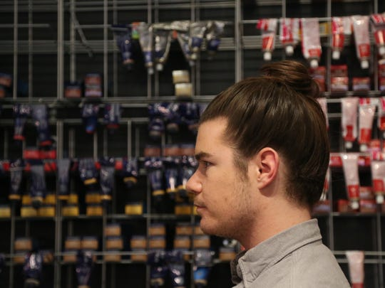 Cory Winegardner shows off his man bun hair style on Wednesday, Jan. 6, 2016, at Bella Salon in Des Moines.