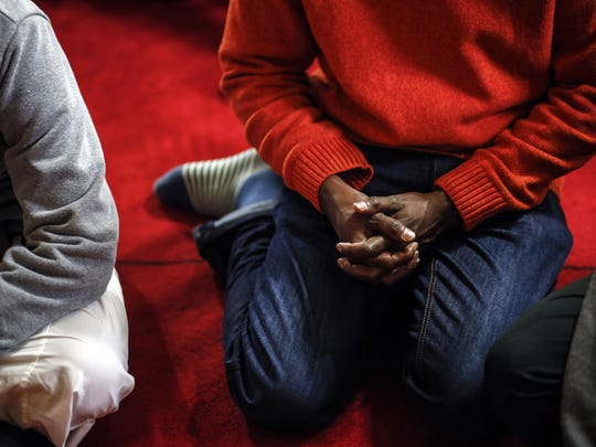 Almardi Abdalla, 39, of Des Moines listens to a sermon