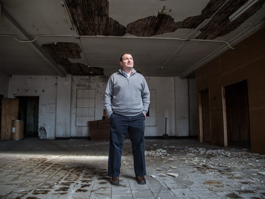 Tim Rypma, member of Bronson Partners stand in a building he's rehabilitating at 1417 Walnut St. Wednesday, Jan. 13, 2016.
