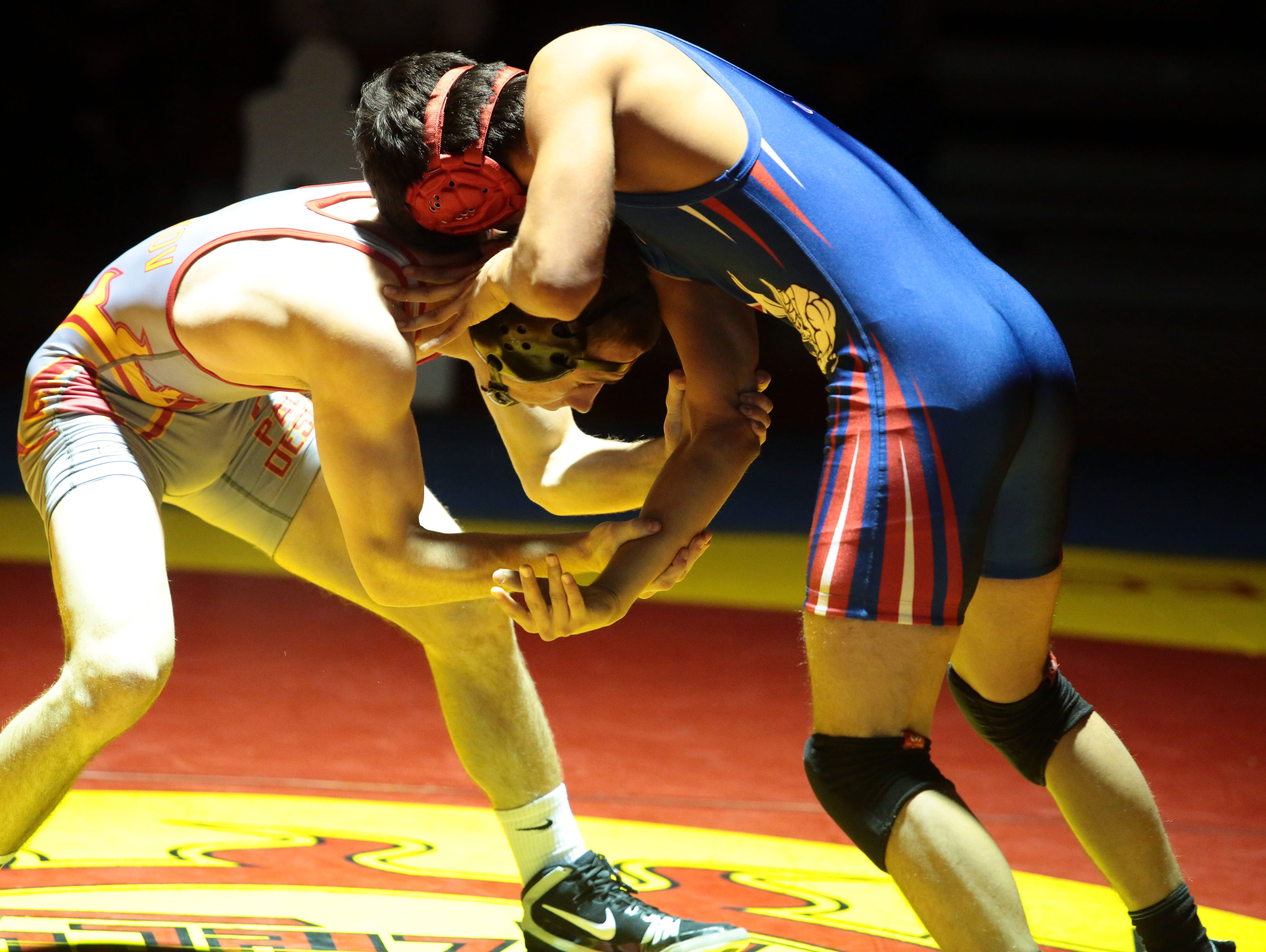 Palm Desert's Chase Overgoag takes on Indio's Chris Rodriguez in the 145 lbs. weight class on Wednesday January 13, 2016 in Palm Desert.