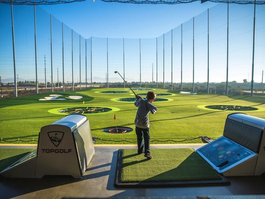 Children can take advantage of the driving range at Topgolf.
