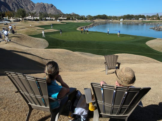 Visitors relax on Adirondack chairs along 17th green on the TPC Stadium Course on Wednesday, January 20, 2016 the day before the start of the CareerBuilder Challenge.