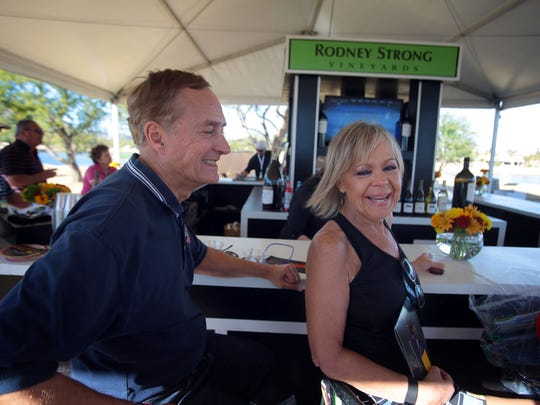 Roger Rehling and his wife April Rehling sample wine at the Rodney Strong Vineyards Wine Bar at Bob Hope Square during the CareerBuilder Challenge on Thursday, January 21, 2016.