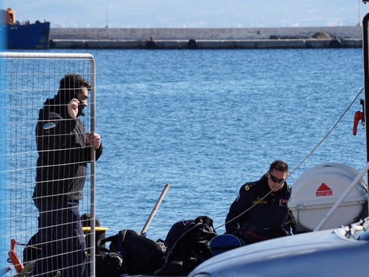 Greek Coast guard officers prepare for a rescue mission at the port of Kalymnos island on Friday, Jan. 22, 2016