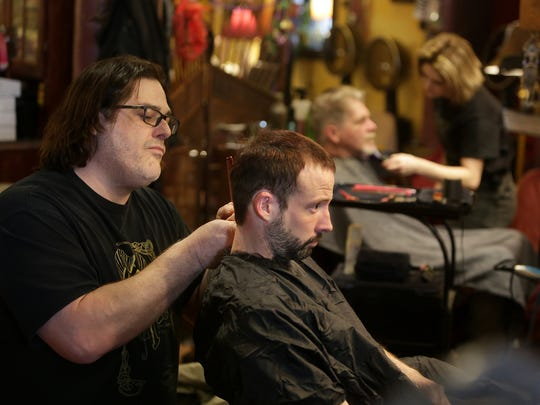 Stylists at Mojo Pie Spa and Salon treated area homeless to haircuts Monday, Jan. 25. Ron Blevins cuts the hair of Dominick Cosolo.