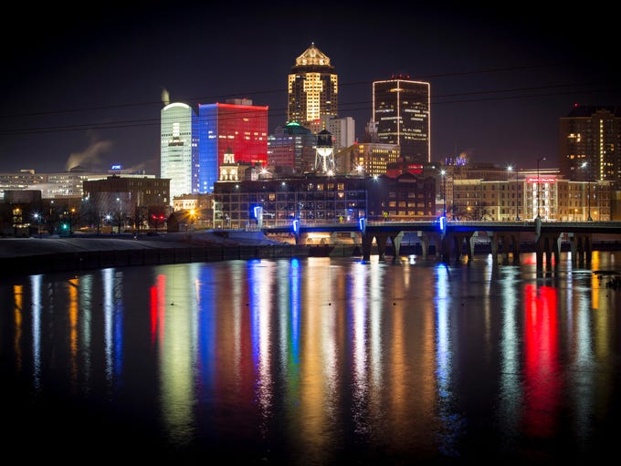 The Des Moines skyline is lit up red white and blue