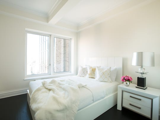 Monique Breaux of POSH Exclusive Interiors kept the penthouse bathed in creams and whites to accentuate the view at penthouse 27.