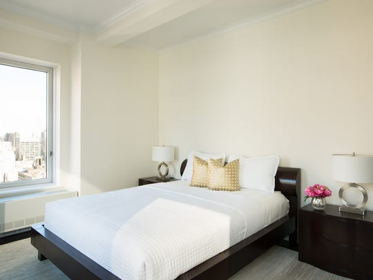 A bedroom in Penthouse 27 at Trump Park Avenue. The space was decorated by Monique Breaux of POSH Exclusive Interiors.