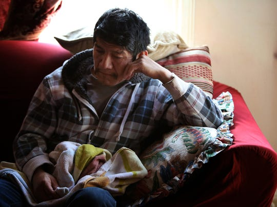 Adrian Vasquez, 51, from rural Guatemala, sits inside of his Carthage apartment he shares with family members. Vasquez fled his homeland on February 17, 2015, with his son, Makferson, 8, after fearing for their lives. Vasquez was threatened by the Mara 18 gang, who killed his brother.