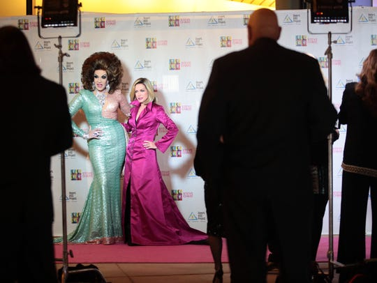 Ethylina, left, and Donna Mills pose for pictures on