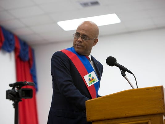 Haiti's president departs to make way for interim government