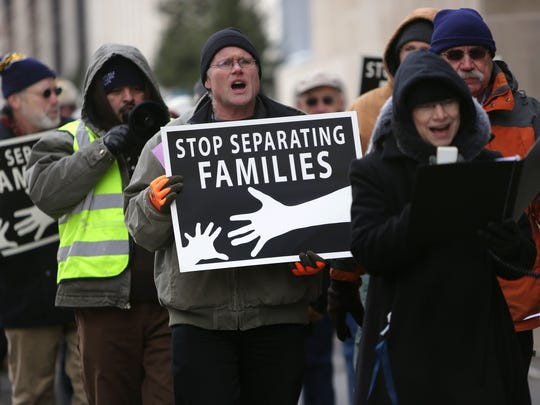 Protestors rallied outside of the John Weld Peck Federal Building in downtown Cincinnati on Wednesday, calling for a change to U.S. immigration policy.