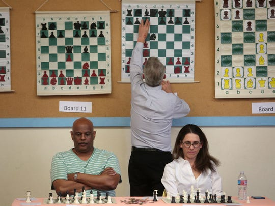 Chess players think about their next move against American Chess Grandmaster, Timur Gareyev, who is playing them blindfolded on Saturday, February 13, 2016 at Demuth Community Center in Palm Springs.
