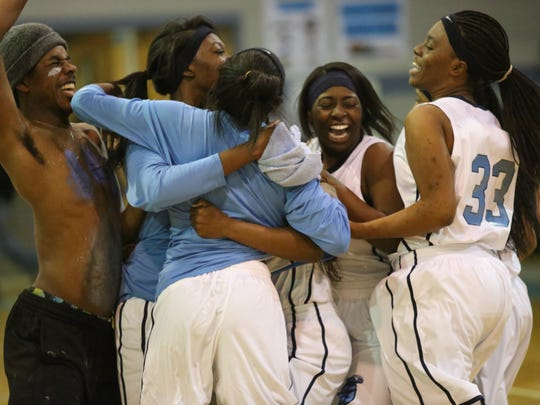 East Gadsden's girls basketball team celebrates after a 61-39 win over Bolles, sending the Jaguars to the state tournament for the first time in 11 years.