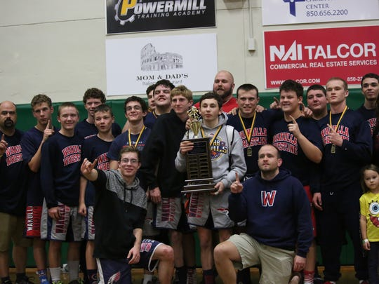 The Wakulla wrestling team captured the championship trophy of the Tri-County Invitational at Lincoln .