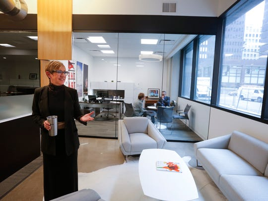 Mary Bontrager leads a tour of the Greater Des Moines Partnership's newly renovated offices.