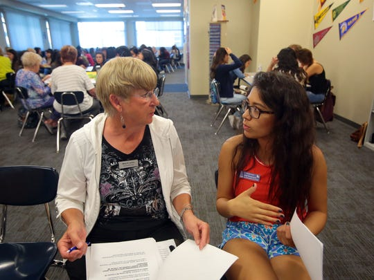 Ophelia Project mentor Mary Larsen and Ophelia ambassador Leiah Elisarraras discuss upcoming Ophelia events during a Ophelia Project session at Indio High School on Thursday, February 18, 2016.
