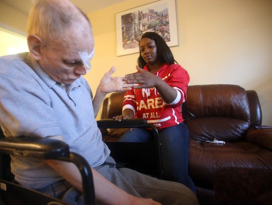 Staff member Jamella Purcell looks after resident Richard
