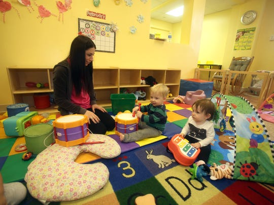 Bianca Timpone cares for one-year olds Brian Stoudt