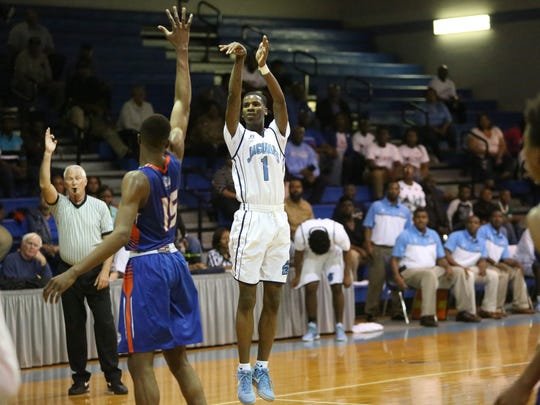 Jacksonville Bolles traveled to East Gadsden on Saturday night and handed the Jaguars a 65-40 defeat in the Region 1-4A final behind 28 points and 12 rebounds from 6-8 forward Collin Smith (15). East Gadsden senior Amaru Bryant (1) scored 20 for his team on six 3-pointers, including five in a 29-25 first half.