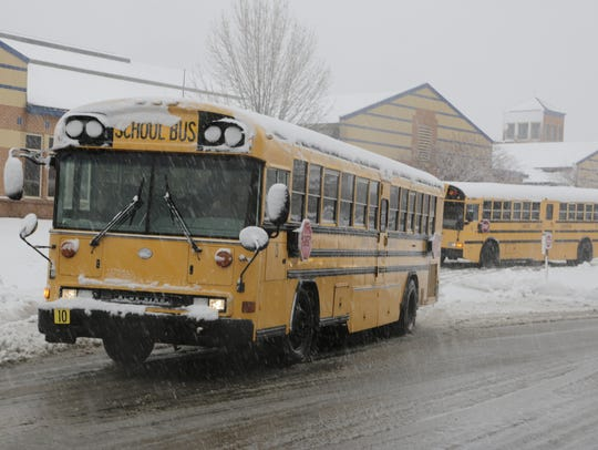 A school bus full of students departs two hours early