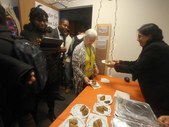 Guests enjoy Halal food at the Rockland Community College Center for Muslim Life office during an opening ceremony Feb. 25, 2016. The center will serve as a gathering place for Muslim students as well as providing outreach to non-Muslim students at the college.