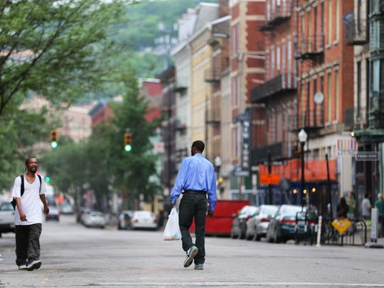 Over-The-Rhine neighborhood in Cincinnati illustrates economic disparity in the city, which some of the city's richest and poorest living practically next door.