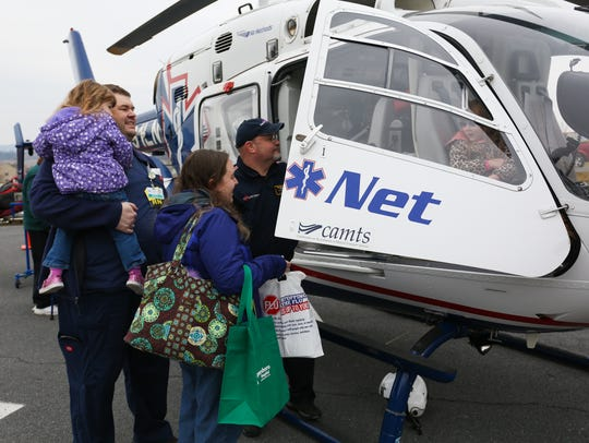 Abby Snyder sits inside the Life Net medical helicopter