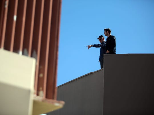 Above: Developer John Wessman, left, stands on the roof of the Town & Country Center in downtown Palm Springs in January 2016. The mid-century shopping complex will be considered for Class I Historic Site status by the Palm Springs City Council.
