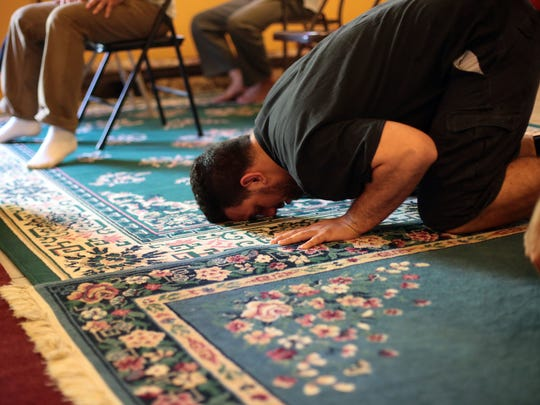 Men attend the noon time prayer service at the Islamic Society of Coachella Valley on Friday, March 4, 2016 in Coachella.