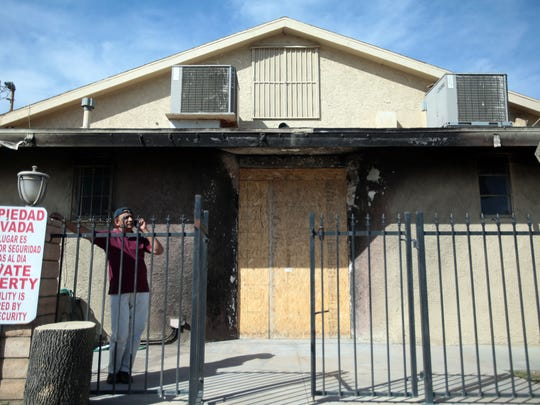 A man waits for his ride outside the the charred Islamic Society of Coachella Valley on Friday, March 4, 2016 in Coachella. The mosque was fire bombed 9 days after the killings in San Bernardino in December 2015.