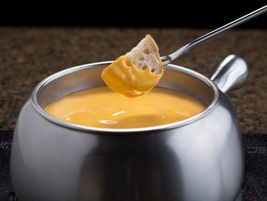 The white bread with cheese fondue at The Melting Pot.