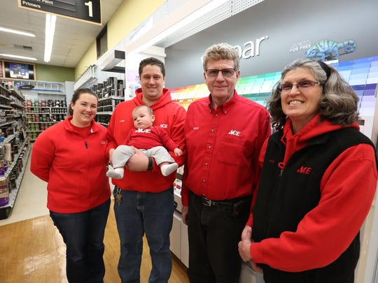 Lindner Ace Hardware owners Dale and Kim Lindner, right, pose for a portrait with their son, Ryan, daughter-in-law, Stefanie, and 4-month-old grandson, Cory, in the Manitowoc store on Wednesday, March 9. The Lindners recently acquired a new store in Little Chute, which will join existing stores they own in Manitowoc and Green Bay.