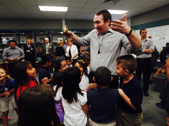 Jason Thomashefsky,  a music teacher at the Rayma C. Page Elementary School is a Golden Apple winner.