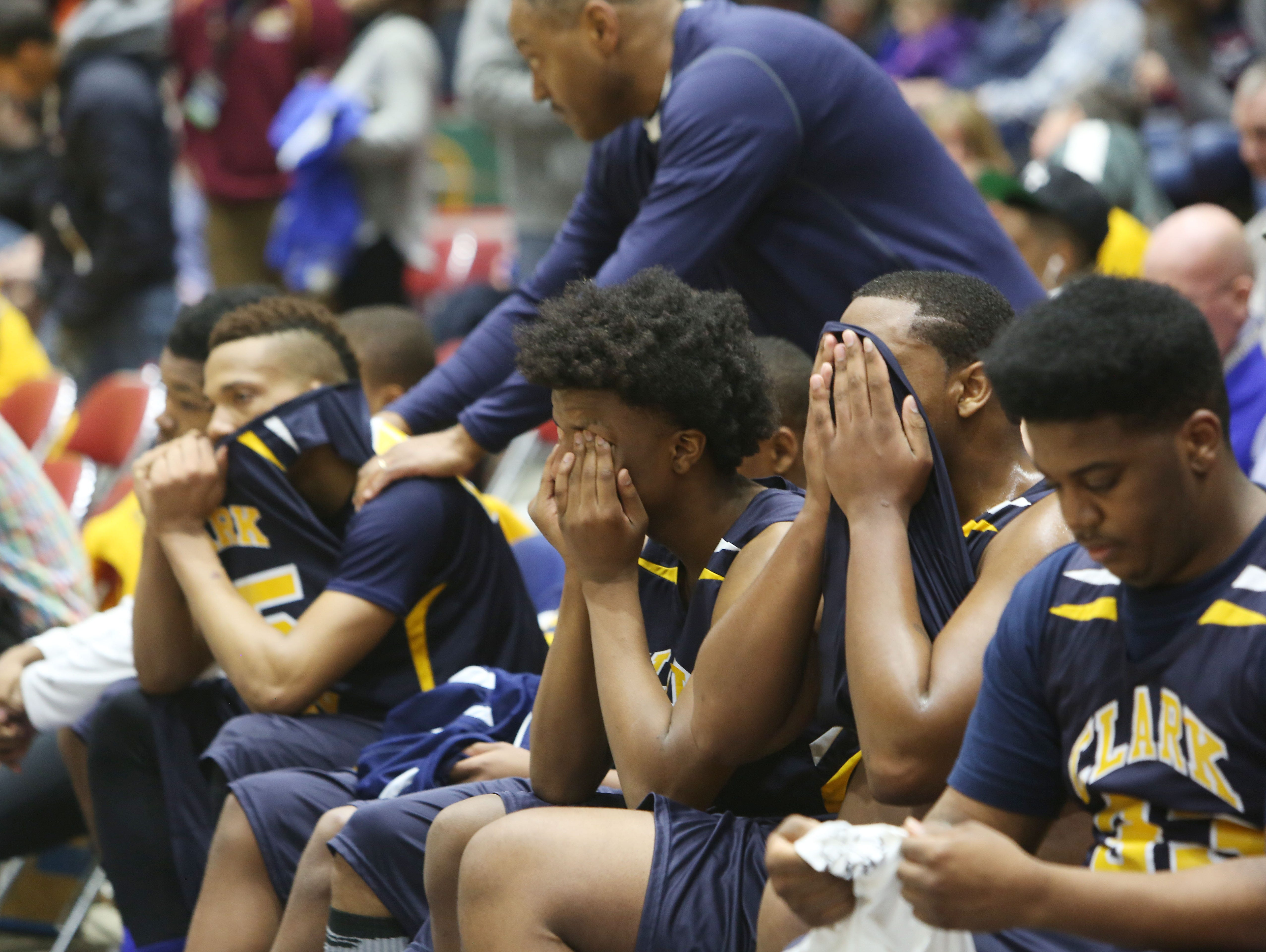 Clark Academy players watch from the bench as their season comes to an end against Oriskany in the boys Class D semifinal at the Glens Falls Civic Center March 11, 2016. Oriskany won the game 59-40.