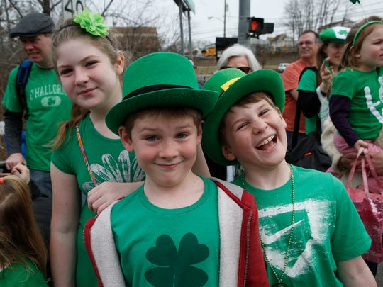 Katherine McGuire, 11, of Yorktown, along with her brothers, Timothy and James, both 9, enjoy the Northern Westchester - Putnam County St. Patrick's Day Parade on March 13, 2016.
