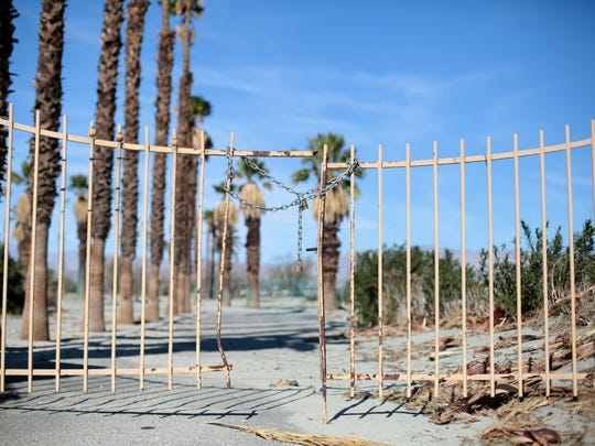 The Verona Road entrance to the closed Palm Springs Country Club in Palm Springs. The withered golf course, has sat vacant for about a decade.