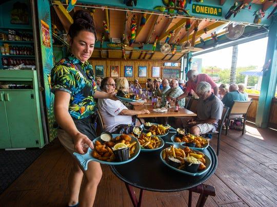 Staci Misner, a server, works at Parrot Key Caribbean
