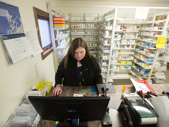 Pharmacy technician Lindsey Thompson fills a prescription at the NuCara Pharmacy in Zearing, Iowa, on Thursday, Feb. 25, 2016.