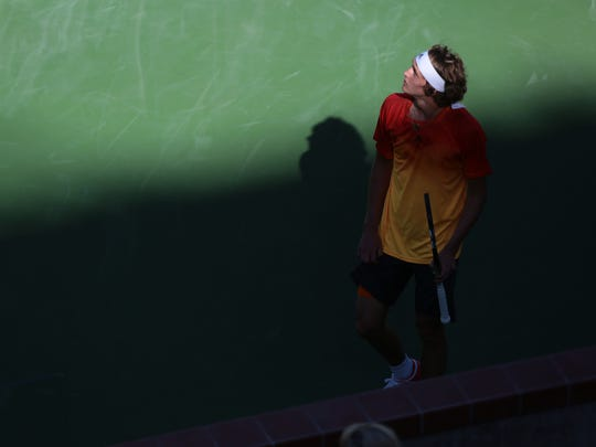 Alexander Zverev, of Germany looks up at Stadium 1 inside the Indian Wells Tennis Garden.