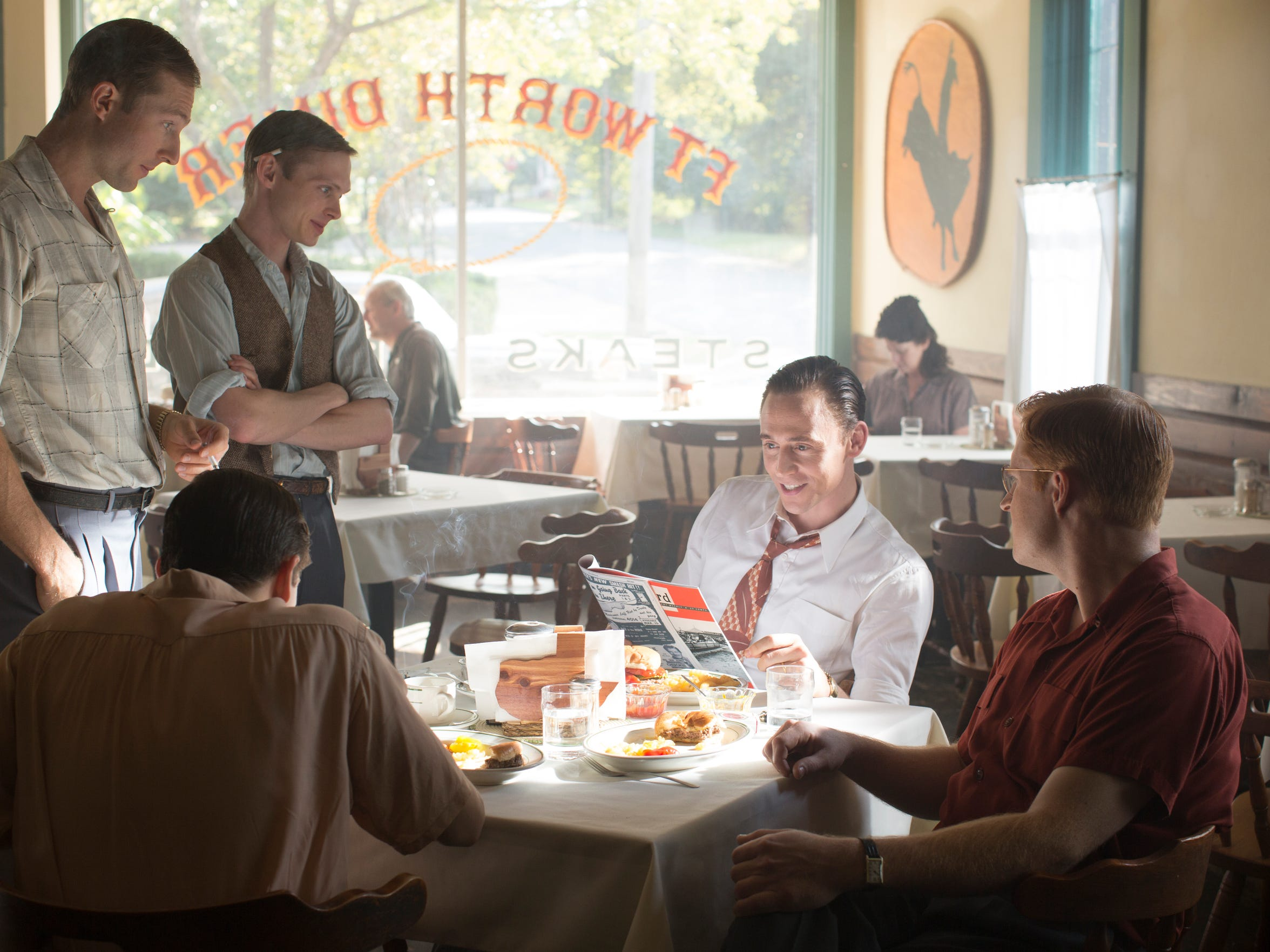 "Left to right: Casey Bond as Jerry Rivers, Joshua Brady as Sammy Pruett, Tom Hiddleston as Hank Williams and Wesley Robert Langlois as Dom Helms in ""I Saw the Light."" The scene was filmed at Jacquelyn's Cafe in Shreveport."