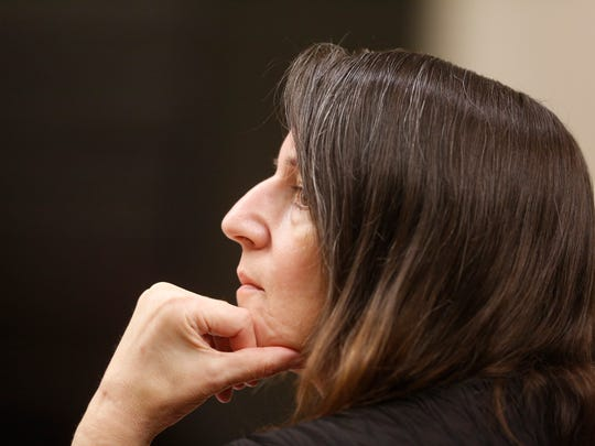 Michelle Lodzinski listens during her murder trial.