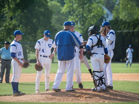 Mercersburg coach John Lowery Jr. talks to his players on the mound. Lowery takes over as head coach of the Mercersburg baseball team after Karl Reisner retired after 25 years with the Blue Storm