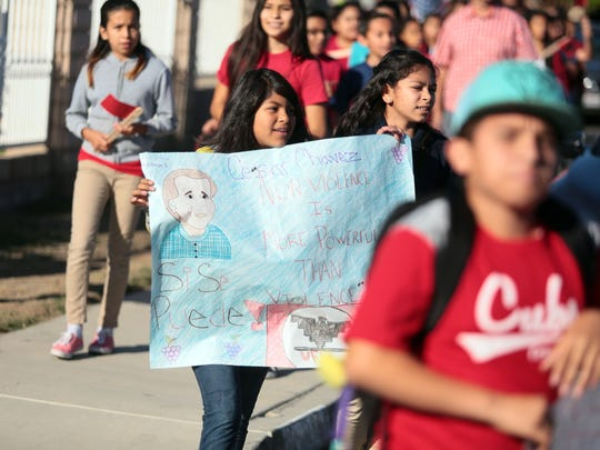 """Cesar Chavez Elementary School reenacted marches by  the United Farm Workers by walking to De Oro Park and back to honor civil rights activist and labor leader Cesar Chavez on Thursday, March 24, 2016 in Coachella. The 1,000 or so students wore colors, carried signs and banners of the United Farm Works and chanted """"Si Se Puede!"""" as they marched. The school is the only one dedicated to Chavez during his lifetime."""